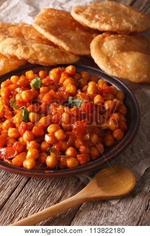 Indian Cuisine: Chana Masala And Puri Bread Close-up. Vertical