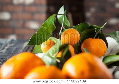 Mandarins With Leaves On Wooden Desk And Towel