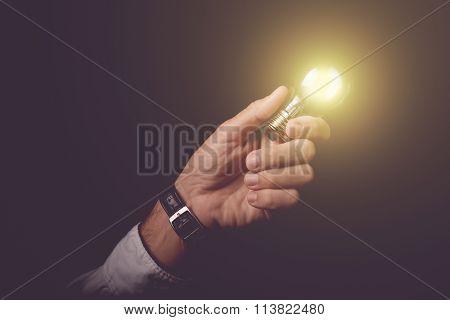 Businessmnan Holding Light Bulb