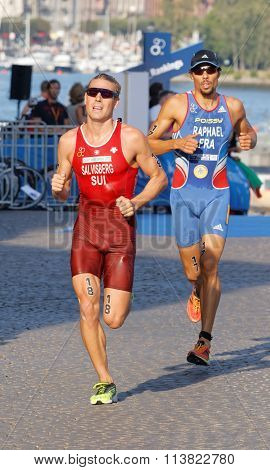 Tough Fight Between Two Colorful Running Triathletes In The Sunshine
