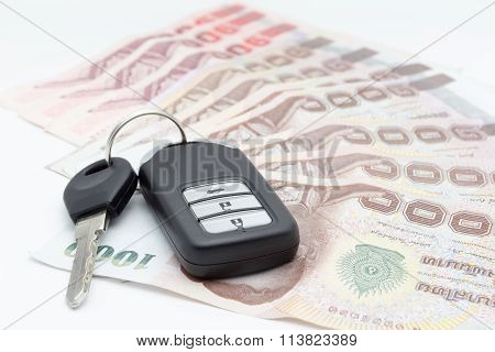 Car Keys And Money Baht On A White Background