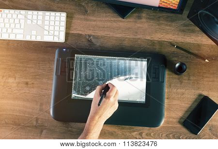 Graphic Designer Working With Digital Drawing Tablet And Pen