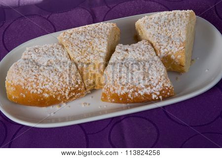 French King Cake On A Wooden Stand. Purple Background.