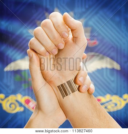 Barcode Id Number On Wrist And Usa States Flags On Background - North Dakota