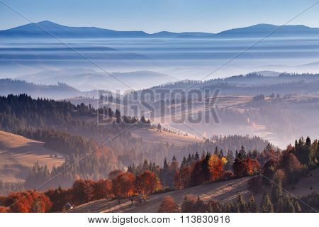 Morning Mist In Mountains. Sunrise And Autumn Mist Over The Hills.