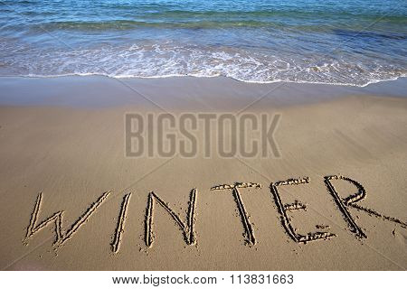 Winter Written On Wet Sand