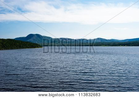 Lake Among Forested Hills And Mountain