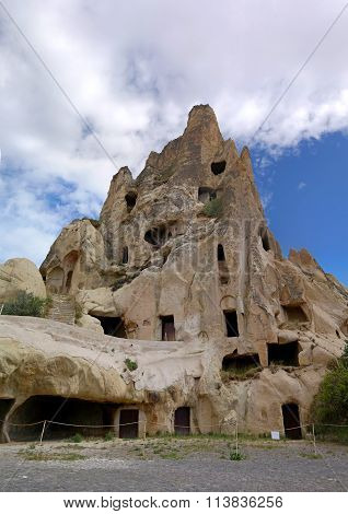 Cappadocia. Turkey. Cave House In The Natural Erosion Formations.