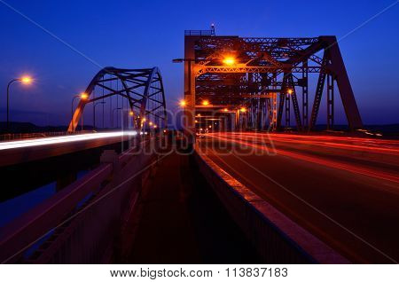 Traffic Crossing Bridges At Night
