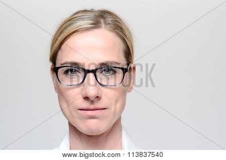 Attractive Blond Woman Wearing Glasses