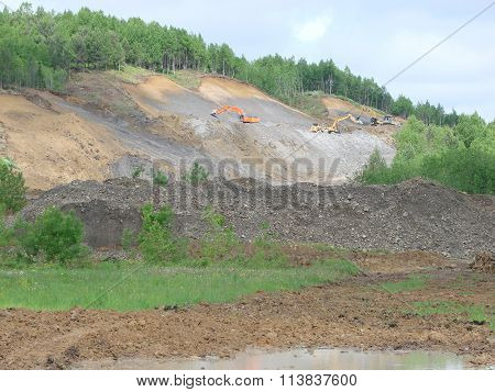 Excavation of a pit. Production of gray crushed stone for road powder. Landscape view of the quarry. ** Note: Visible grain at 100%, best at smaller sizes