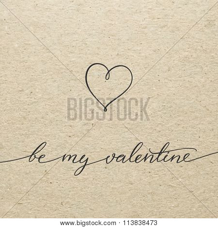 Be my Valentine for Valentines day card. Calligraphy lettering on craft cardboard background. Love design concept.
