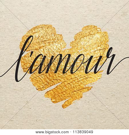 French Valentines day card. L'amour calligraphy lettering with gold paint heart on craft background. Hand drawn letters.