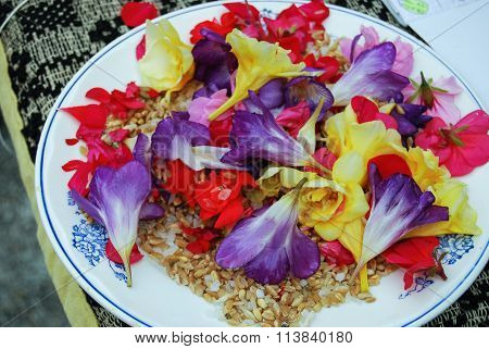 View of an assortment of edible flowers with plate
