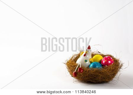Decorative Hen And Colored Easter Eggs