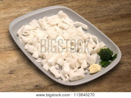 Calamari Ring On Wooden Background.