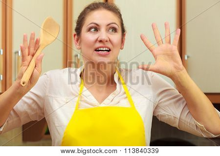 Frightened Housewife With Ladle