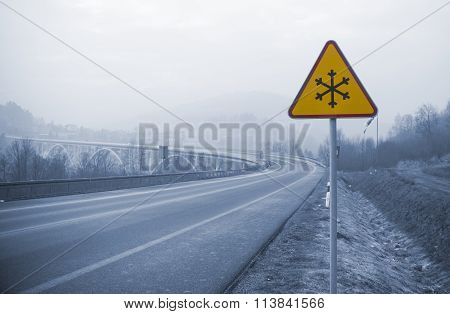 Snowy Road With Frozen Sign In Winter, Cold Concept