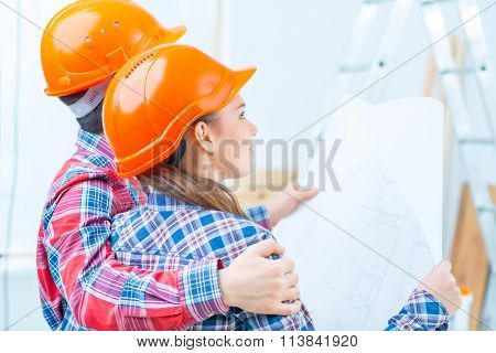 Happy couple doing renovation