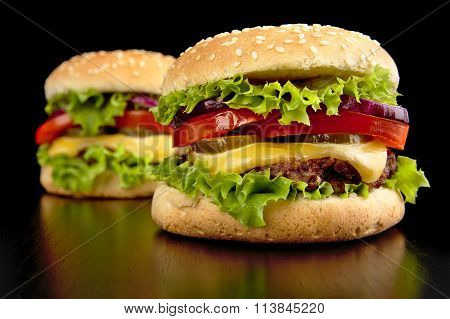 Big Two Cheeseburgers Isolated On Black Background
