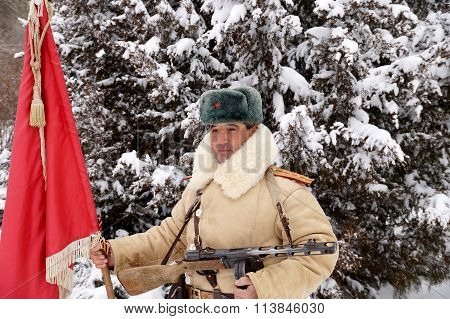 Defender Of Stalingrad In A Winter Form With A Red Banner