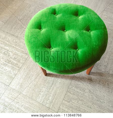 Green Velvet Stool On Tiled Floor