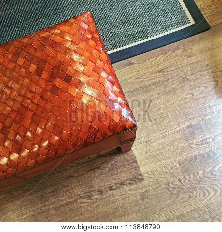 Orange Leather Bench On Wooden Floor