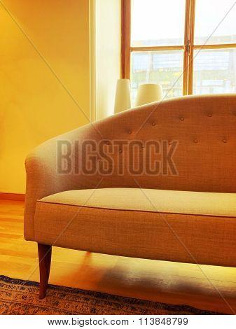 Elegant Sofa In A Sunlit Room With Big Window