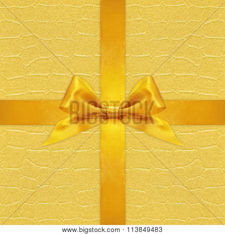 Shiny Golden Satin Ribbon Bow On Gold Background