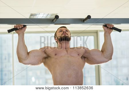 Athlete doing pull-ups