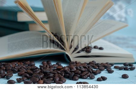 Coffee beans in the background of a open book