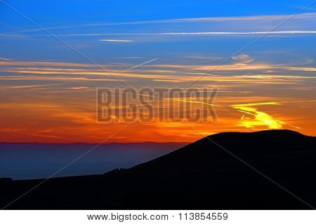 Sunset Over The Mountain