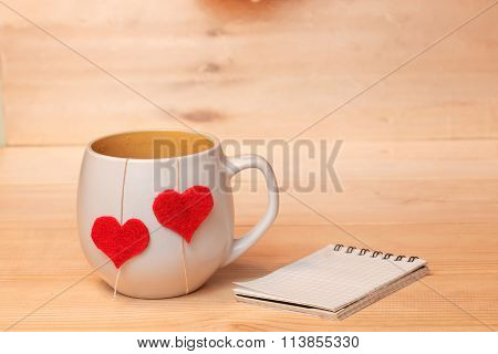 Cup of tea with hearts and note
