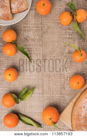 Natural Sweet Clementines On Rustic Table From Above