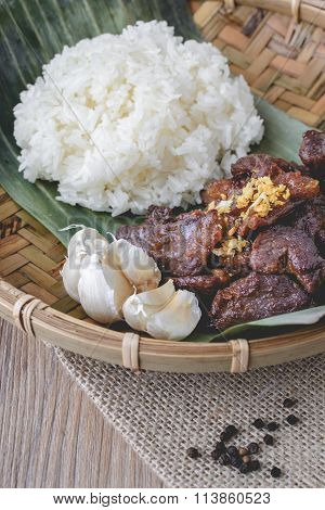 Deep Fried Marinated Beef Thai Style On Wood Basket And Wood Background, Thai Food, Thai Cuisine