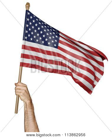 Hand proudly waving the national flag of the United States