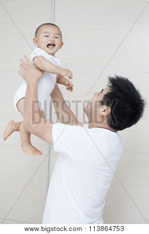 Tender Moment Between Real Chinese Father And Son