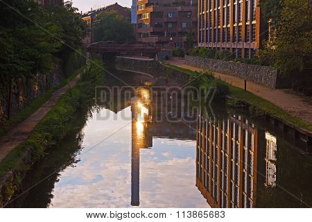 Canal waters with buildings and sun reflection, Washington DC, USA.