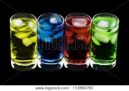 4 Crystal Glasses With 4 Different Coloured Cold Drinks