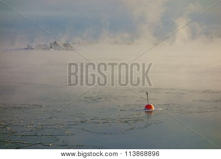 Red buoy in the freezing Baltic Sea in Helsinki, Finland