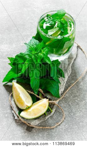 Cocktail Glass - Mint, Ice, Rum And Lime On Stone Pedestal .