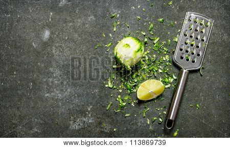 Lime Zest And Grater . Lime Background. On Stone Table.