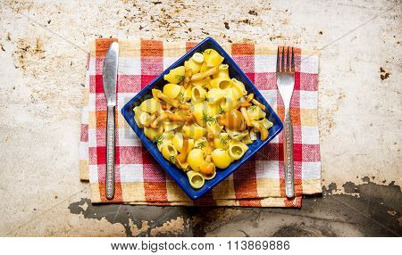 Delicious Pasta With Mushrooms On A Plate On The Fabric.