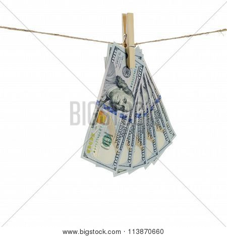 Dollars hang on clothes-rope