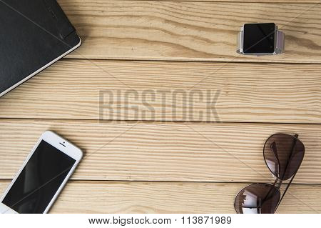 modern young person. Different objects on wooden background.