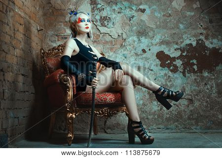 Woman Sitting  Chair, Holding  Sword In His Hand.