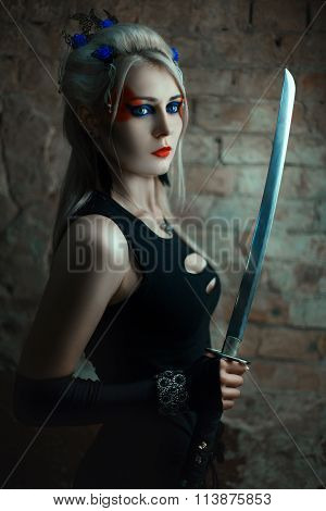 Portrait Of A Girl Warrior With Sword.