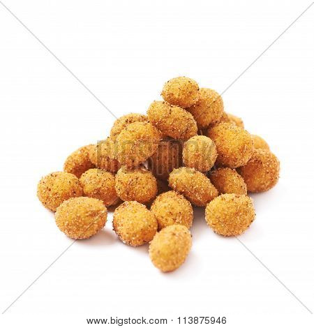 Pile of crunchy coated nuts isolated