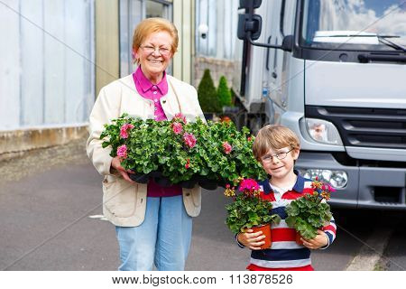 grandmother and little kid boy with flowers