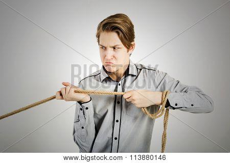 Teen Boy Pulls Rope
